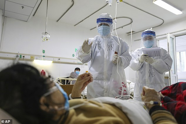 Medical workers check on the conditions of patients in Wuhan's Jinyintan Hospital on Thursday. The hospital has been designated to treat critical sufferers of theCOVID-19 virus