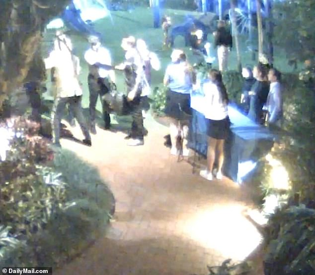 Rod Stewart appears to punch security guard Jessie Dixon in an altercation on New Year's Eve, according to footage obtained exclusively by DailyMail.com