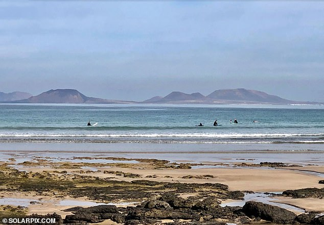 Mr Deshe was pulled out of the ocean by surfers after getting into difficulties off spectacular Famara Beach