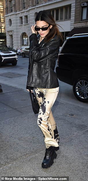 Runway beauty: Kendall wore cowhide satin pants and a white crop top for the girls' outing