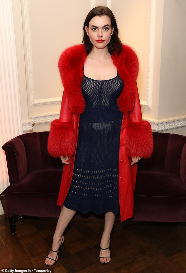 Dramatic:Also there was model Charli Howard. The 28-year-old cut a very glamorous figure in a black dress worn underneath a scarlet coat with a thick furry collar