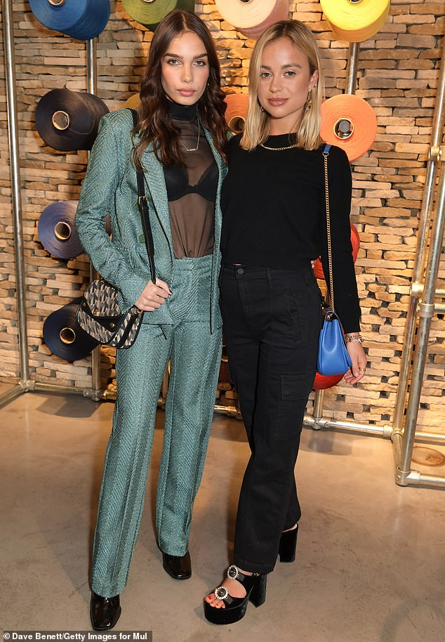 Work it:Wearing a teal dinner jacket and straight cut suit pants Hana kept it chic while flashing her black bra in a sheer roll neck top (pictured withLady Amelia Windsor)