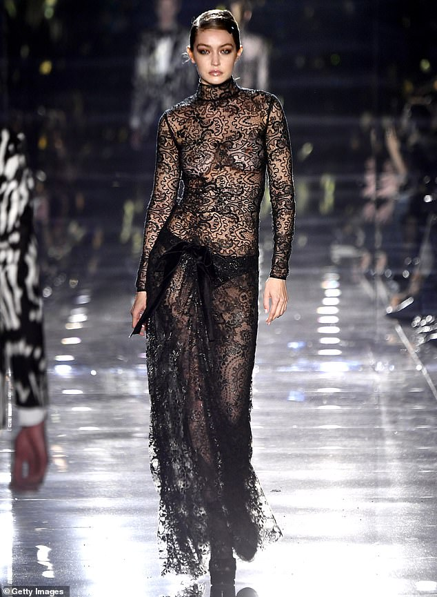West coast: Gigi is pictured on the runway for Tom Ford on Friday. The designer moved his show to Los Angeles and to two days before the Oscars to attract an A-list crowd