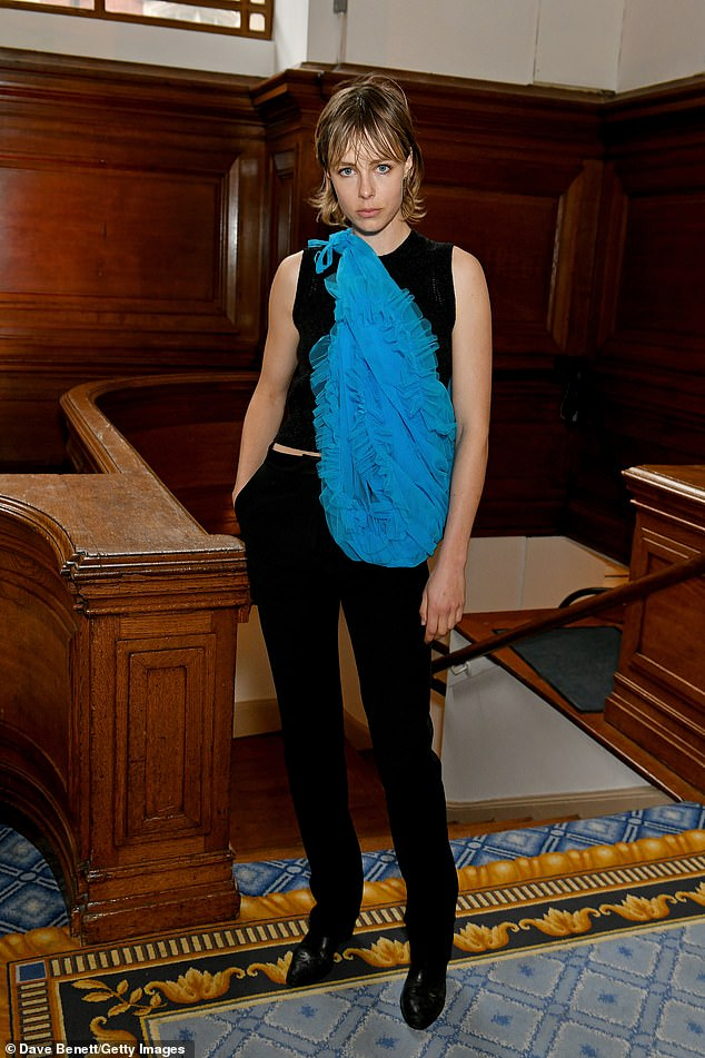 Striking: Model Edie Campbel wore a bright blue chiffon cross-body bag over her black outfit