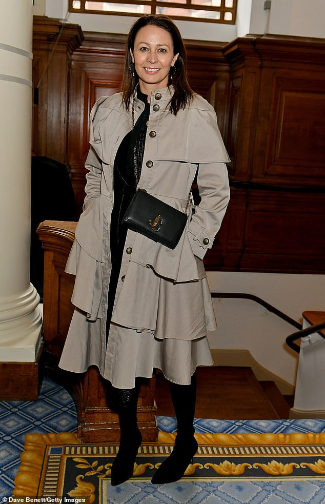 Elegant: CEO of the British Fashion Council Caroline Rush looked chic in a asymmetrical coat