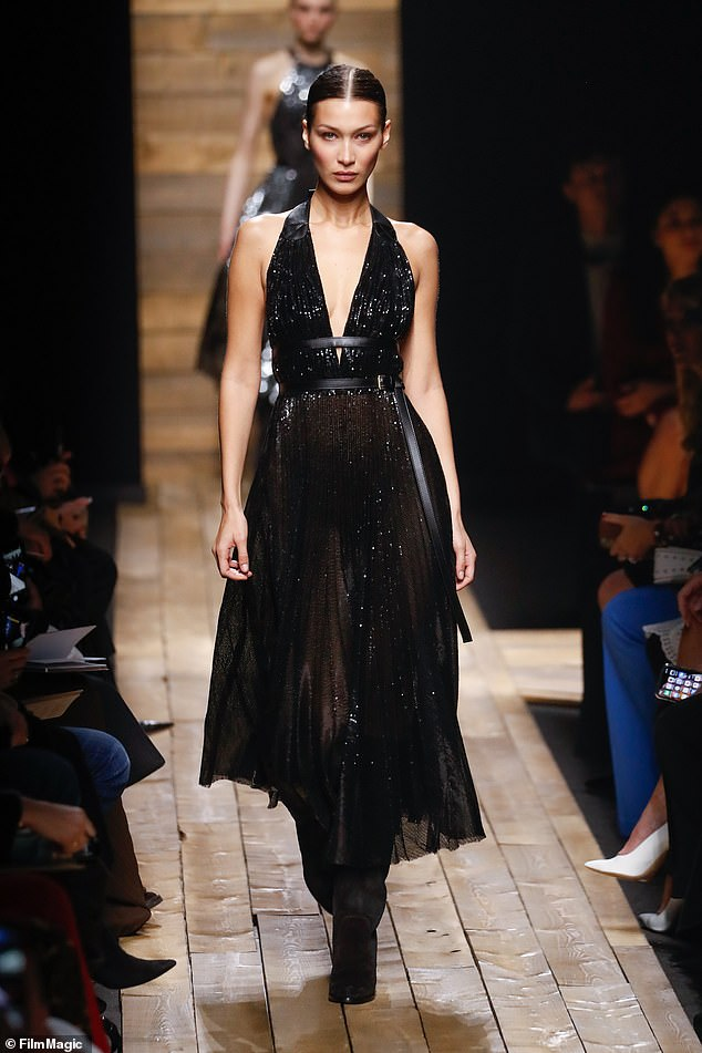 For you Michael: Bella stunned on the runway for Michael Kors in a glittering black gown