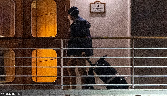 A passenger with his belongings was spotted on board the ship before the evacuation of American passengers