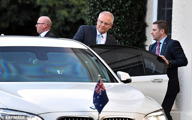 General Motors gave Prime Minister Scott Morrison just three minutes' notice of its decision to axe the Holden brand after 72 years. The PM is pictured getting out of a BMW 5-series