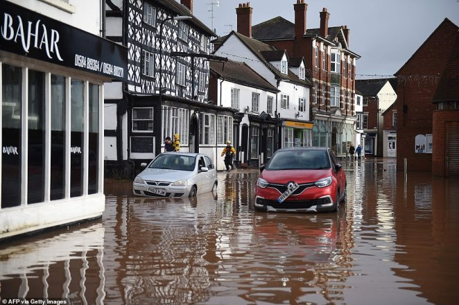Cars are pictured stranded in the middle of Hereford after water levels rose amid Storm Dennis