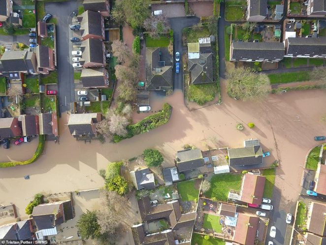 Aerial images show the extent of flooding in Hereford, Herefordshire, on Monday after the nearby river burst its banks over the weekend