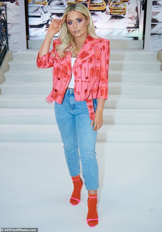 Dressed to impress: The blonde Strictly Come Dancing star wore a statement cerise jacket with an abstract red print, thick waist belt and shoulder pads straight from the 80s