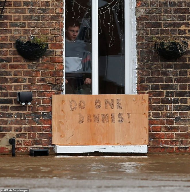 One fed-up resident in York put a 'Do one Dennis' sign to block the water from entering his home in the city