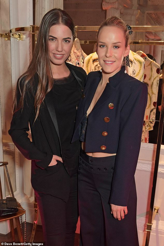 Say cheese! Model Amber kept her brunette tresses poker straight alongside her sartorial chic-inspired outfit as she headed into theTemperley presentation last Friday with Hum Fleming