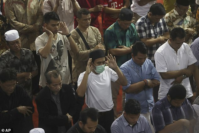 Worshippers at theIstiqlal Mosque in Jakarta pray their country remains free of the virus