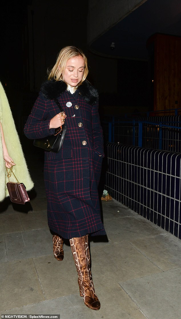 Amelia was later pictured rocking a faux fur trim checked wool coat as she left the parties with pals