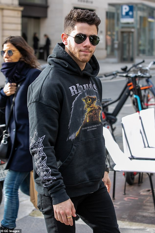Relaxed: the singer cut a discreet figure in the signed hoodie as he left for the day during a break from the Jonas Brothers Happiness Begins tour