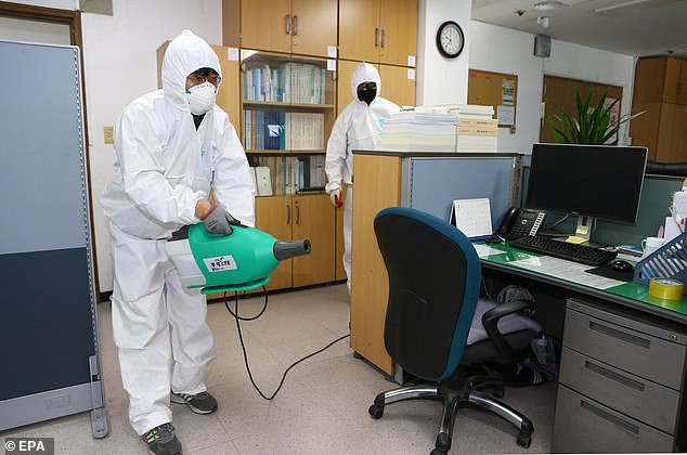 KCDC designated Daegu, which has a population of 2.5million, and Cheongdo, home to around 43,000, as 'special zones' (pictured, a health worker disinfects an office in Daegu)