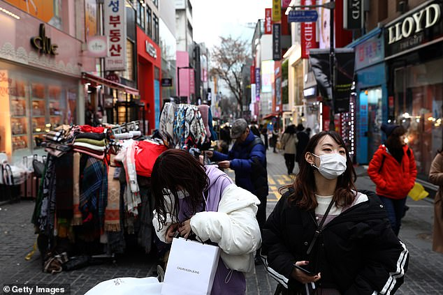 KCDC also said they had a list of 9,300 people who had attended church services, around 1,200 of whom had complained of flu-like symptoms (pictured, people wearing masks)