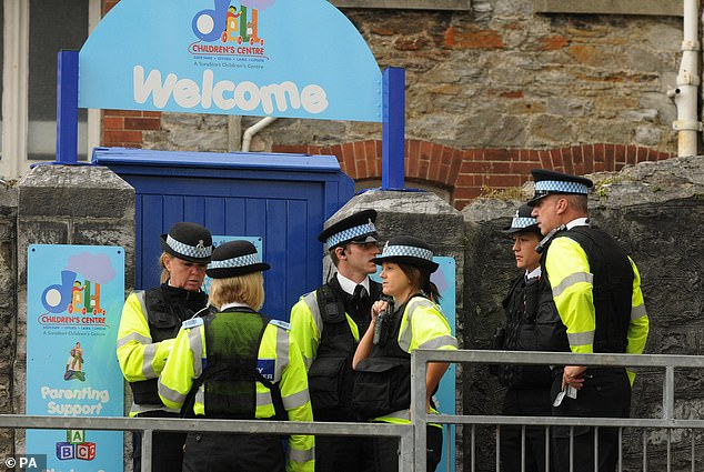 Police are pictured outside Little Ted's after George's arrest in June 2009