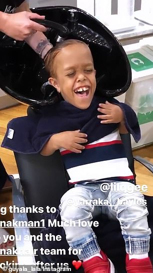 Quaden smiles as he gets his hair washed