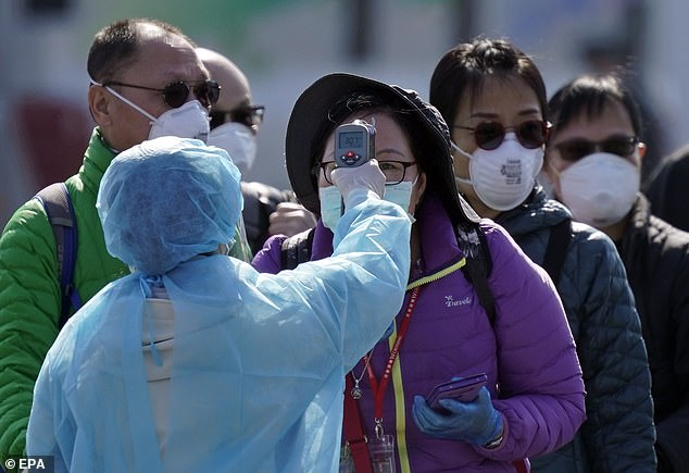 The virus infected 80,000 - including 690 passengers on board the Diamond Princess cruise ship in Japan. The picture shows passengers who leave the ship on February 21 after a two-week quarantine