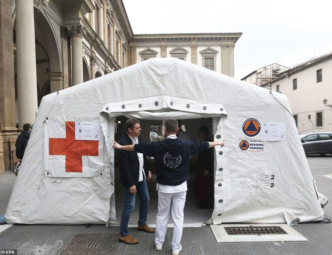 A pre-triage medical tent is set up in front of the Santa Maria Nuova hospital in Florence, Italy, after a 60-year-old businessman in the city was tested for coronavirus after returning from Singapore