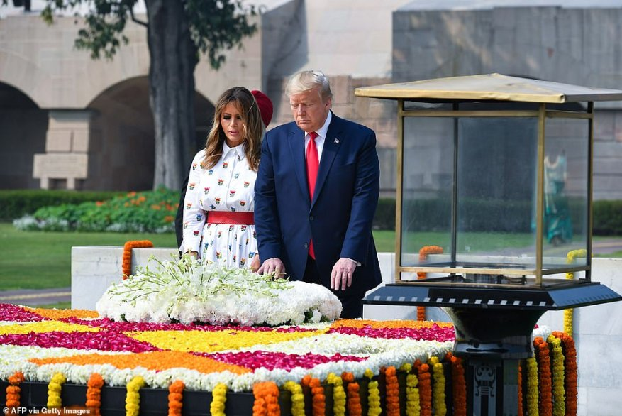 President Donald Trump and First Lady Melania Trump lay a wreath at the memorial for Mahatma Gandhi