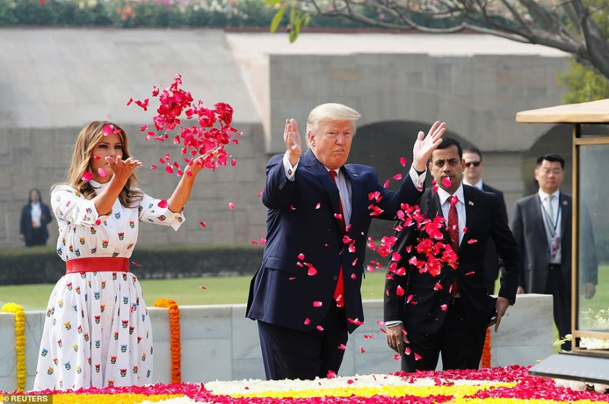 President Donald Trump and first lady Melania Trump pay tribute to Mahatma Gandhi at his memorial