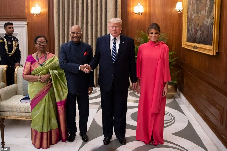 Indian President Ram Nath Kovind and his wife Savita Kovind stand with President Donald Trump and first lady Melania Trump as they arrive for a state banquet at Rashtrapati Bhavan