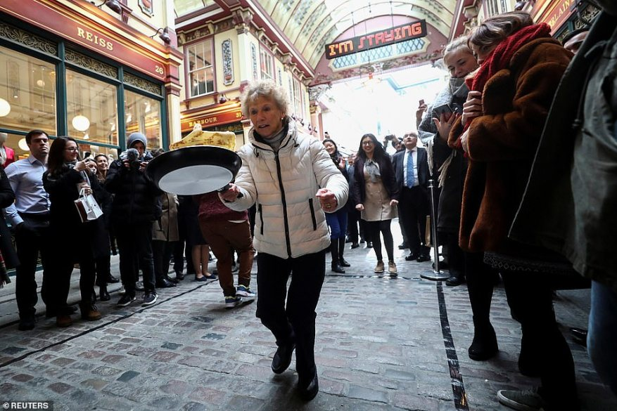 Elsewhere, a multitude of pancake races have seen participants young and old precariously carry their floury creations through the streets in front of hundreds of spectators.At Leadenhall Market's race, in East London, an elderly woman was seen concentrating deeply as she flipped her pancake while amid a throng of onlookers
