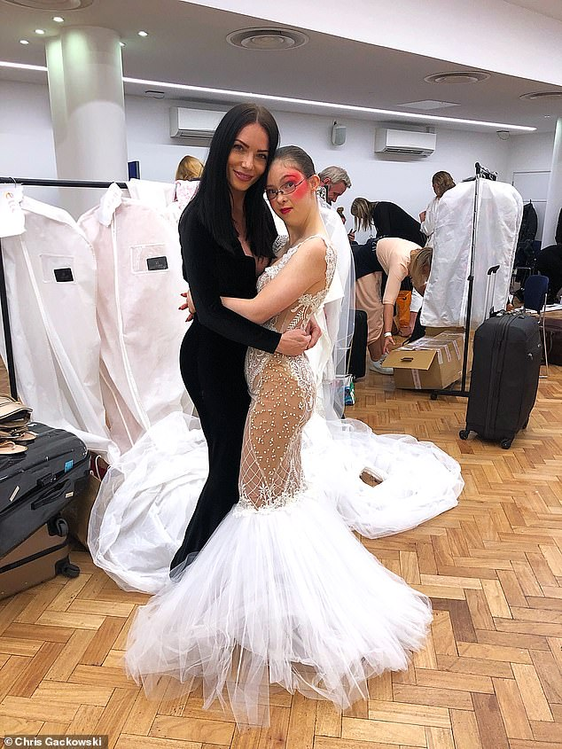 April says she was the first designer to usefirst designer to use models of diversity at London Fashion Week, she is pictured with her main model, who has down syndrome