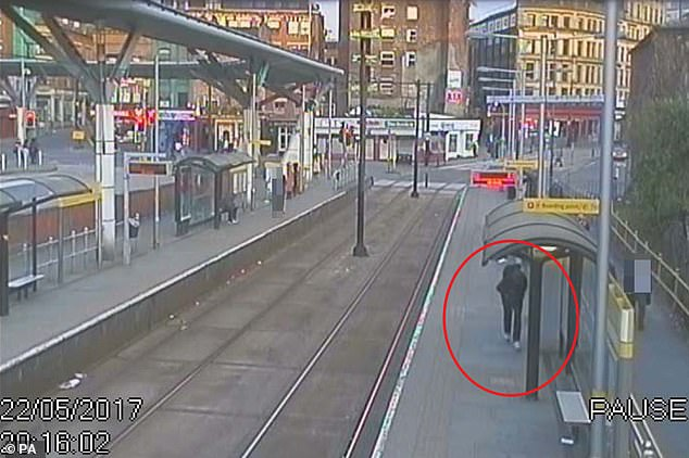Abedi getting ready to board the Metrolink tram, circled in red, at 8.16pm
