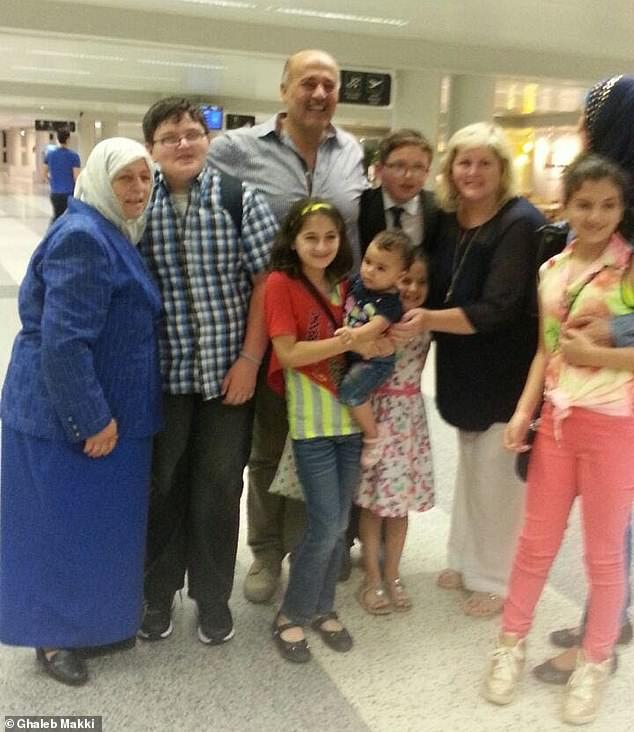 Yousef is in the black suit. His brother Mazen is in the checked shirt. At the airport in Lebanon with his family