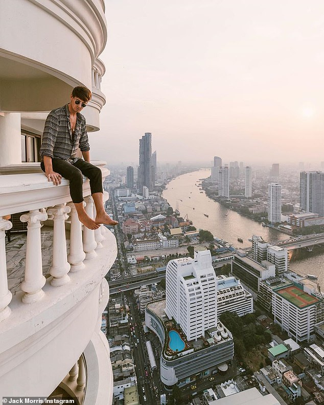 Jack Morris - who has more than 2.7 million followers -has come under fire on social media for posing in a 'dangerous' stunt after posting a picture of himself hanging off a hotel balconyin Bangkok, Thailand