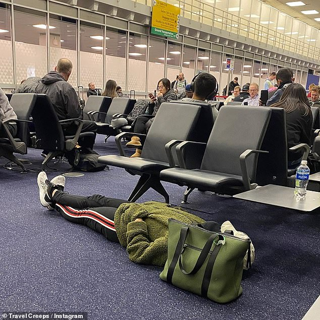 A traveller has been roasted online for taking up two seats at a busy departure lounge, despite the fact she isn't sitting on them (pictured at the airport)