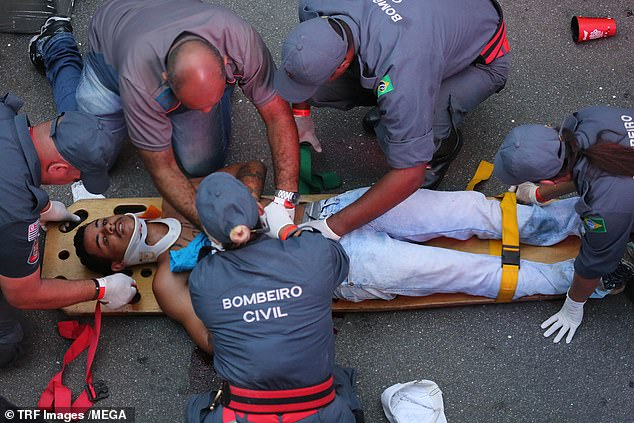 Gunshots were fired during the carnival in Brazil, injuring two people and causing the street party to be cancelled