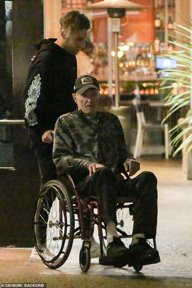 Casual:James kept a low-profile on the outing as he donned a baseball cap and camouflage jacket