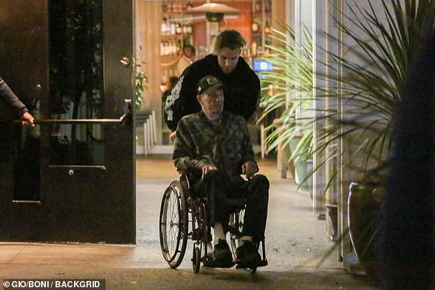 Frail:Hollywood legend James Caan looked frail as he was pushed in wheelchair by his son Jacob on Tuesday