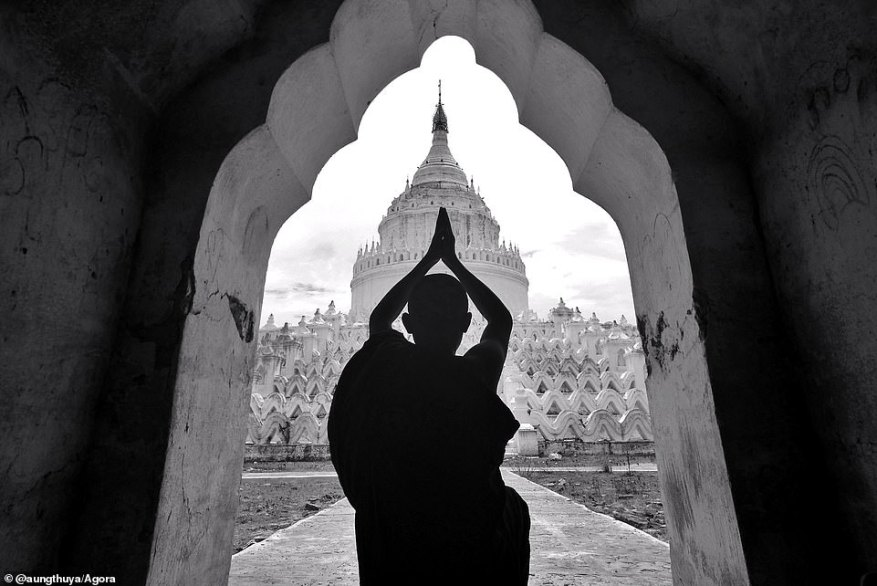 This image, called The Pilgrim, was snapped by photographer @aungthuya at the Hsinbyume Pagoda on the western bank of the Irrawaddy River in Myanmar. The photographer explained: 'When I got there, I noticed a young novice paying his respects in this incredible framed view'