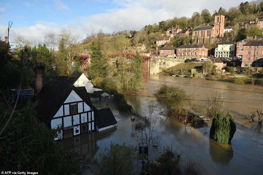 Homes submerged in flood water in Ironbridge, Shropshire, today after further rain pushed water levels even higher