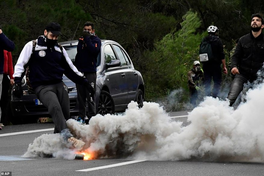 The Athens government infuriated residents of five Aegean islands by announcing two weeks ago that it would expedite the construction of secured detention centres to replace open-access, severely overcrowded camps.A protester kicks a tear gas canister thrown by riot police during clashes