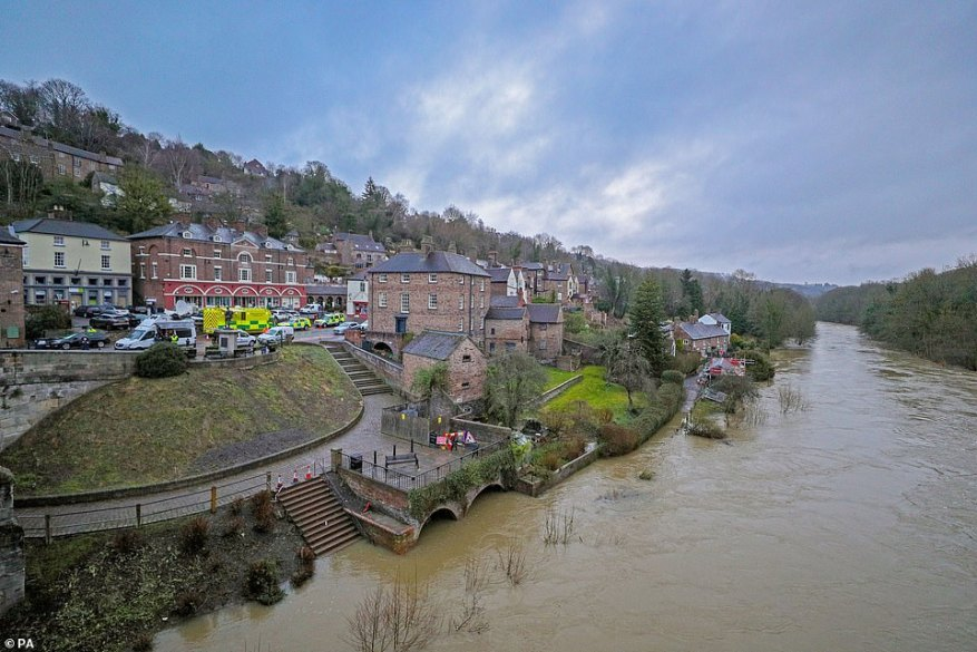 Ambulances and police vehicles in Ironbridge, Shropshire, today after residents in the area were told to leave their homes