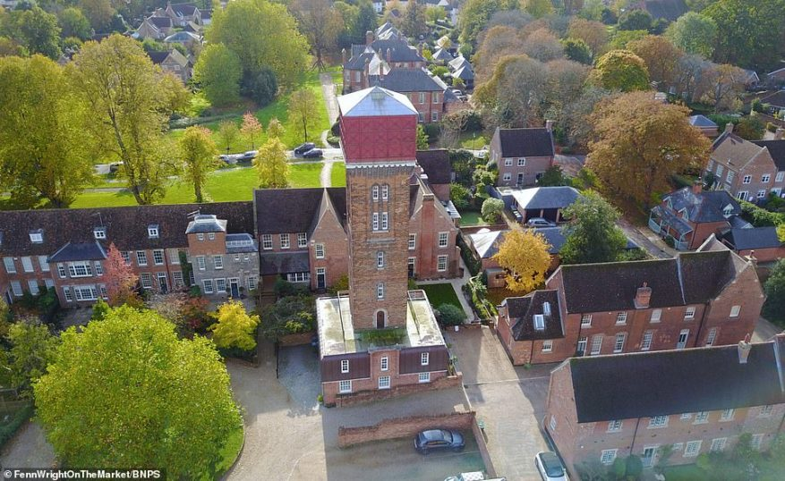 The 100ft-tall structure towers over neighbouring properties in the rural, picturesque Suffolk village of Melton