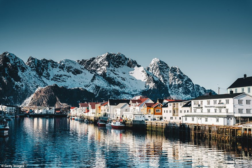 The wooden huts in the centuries-old fishing villages on the Lofoten Islands are a charming sight on the Arctic archipelago. Pictured is the village ofHenningsvær