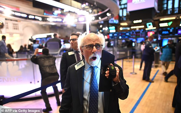 Trader Peter Tuchman reacts at the opening bell on the New York Stock Exchange on Thursday as the Dow opens down another 500 points and the market enters correction territory