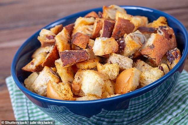 Researchers hope to take bread that hasn't been sold by bakeries and supermarkets or used by people at home and turn it into a medium for growing yeast. This stock image shows leftover bread turned into a bowl of croutons for soup or salad