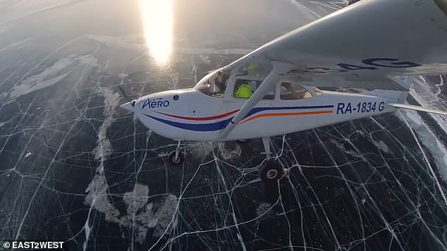 Their landing on to the lake comes aftera stern warning from the Russian Emergencies Ministry to drivers taking cars on winter roads on the frozen expanse. The risk of ice drift, cracks and thin ice means there are many risks when landing on the ice