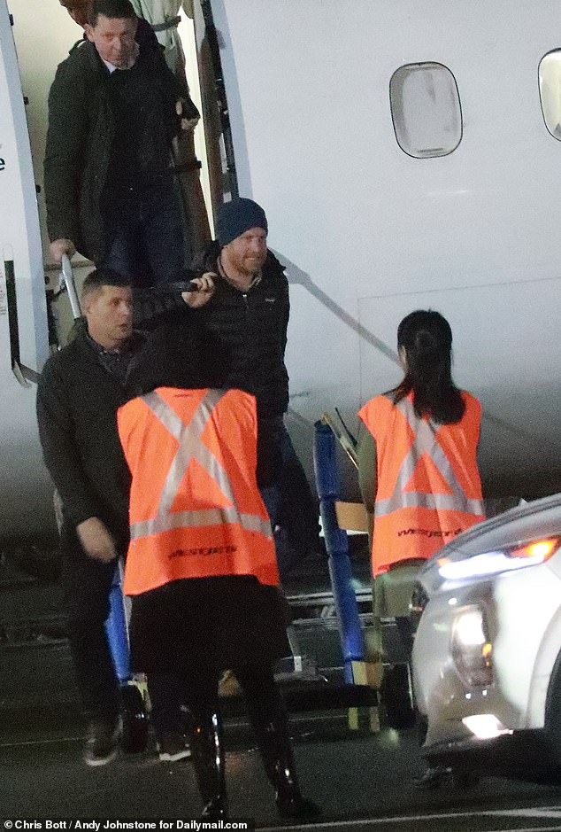 Prince Harry is pictured above leaving Victoria International Airport in Victoria
