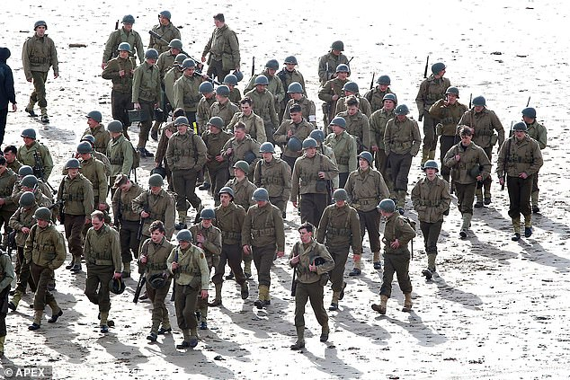 Intense scenes: Extras dressed in soldiers uniforms could be seen at Saunton Beach in North Devon, where they ran across the beaches with their guns in hand