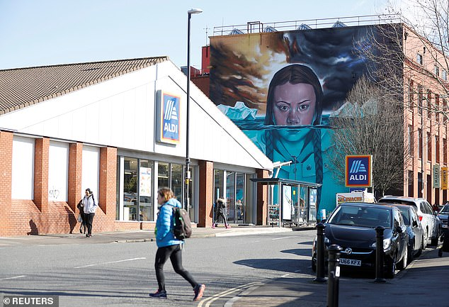 The climate change activist will also visit a50ft high mural (seen on the side of an old factory building) of herself which was painted by local artist Jody Thomas
